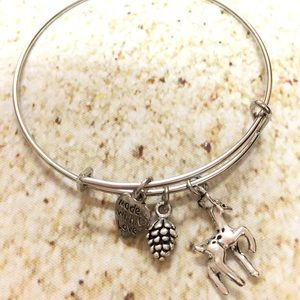 silver plated deer and pinecone charm bracelet